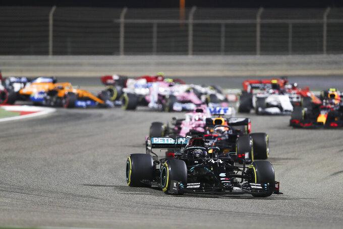 Mercedes driver Lewis Hamilton of Britain leads at the start of the Formula One Bahrain Grand Prix in Sakhir, Bahrain, Sunday, Nov. 29, 2020. (AP Photo/Kamran Jebreili, Pool)