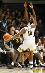 Alabama State's Kevin Holston (2) is trapped by Virginia Commonwealth's Vince Williams (10) and Issac Vann during an NCAA college basketball game in Richmond, Va., Monday, Nov. 25, 2019. (James H. Wallace/Richmond Times-Dispatch via AP)