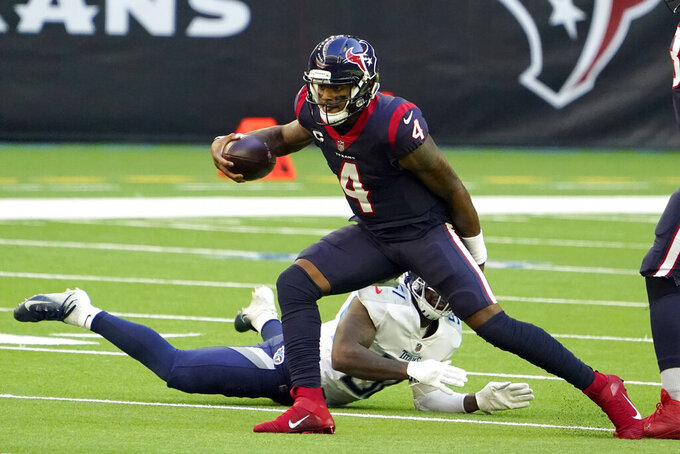 Houston Texans quarterback Deshaun Watson (4) scrambles away from Tennessee Titans linebacker David Long Jr. during the first half of an NFL football game Sunday, Jan. 3, 2021, in Houston. (AP Photo/Eric Christian Smith)