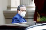 Political deputy at the Ministry of Foreign Affairs of Iran, Abbas Araghchi, enters the 'Grand Hotel Wien' where closed-door nuclear talks take place in Vienna, Austria, Wednesday, May 19, 2021. (AP Photo/Lisa Leutner)