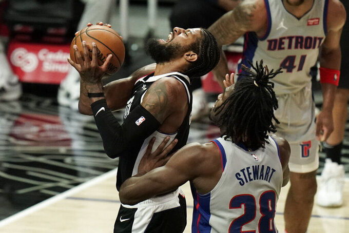 Detroit Pistons' Isaiah Stewart, right, fouls Los Angeles Clippers' Paul George during the first half of an NBA basketball game Sunday, April 11, 2021, in Los Angeles. (AP Photo/Jae C. Hong)