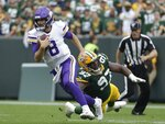Minnesota Vikings' Kirk Cousins runs past Green Bay Packers' Kenny Clark during the second half of an NFL football game Sunday, Sept. 15, 2019, in Green Bay, Wis. (AP Photo/Morry Gash)