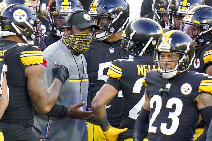 Pittsburgh Steelers head coach Mike Tomlintalks with his defense as time runs down during the second half of an NFL football game against the Indianapolis Colts, Sunday, Dec. 27, 2020, in Pittsburgh. (AP Photo/Gene J. Puskar)