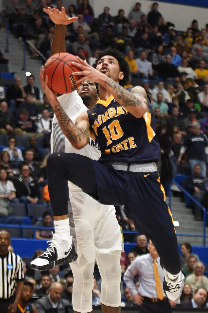Murray State's Tevin Brown (10) goes up to the basket as Marquette's Sacar Anim defends during the second half of a first-round game in the NCAA men's college basketball tournament Thursday, March 21, 2019, in Hartford, Conn. (AP Photo/Jessica Hill)