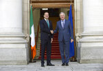 Taoiseach Leo Varadkar meets with Michel Barnier, the EU's Brexit negotiator, ahead of a meeting at Government Buildings in Dublin, Monday, Jan. 27, 2020.  Ireland's prime minister has warned Britain that Brexit is far from finished -- and the European Union will have the upper hand in upcoming negotiations on future relations between the two sides. (Damien Eagers/PA via AP)