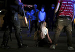 A demonstrator refuses to move out of the street during the waning moments of a protest over the murder of George Floyd early Monday, June 1, 2020. (Daily Memphian via AP)