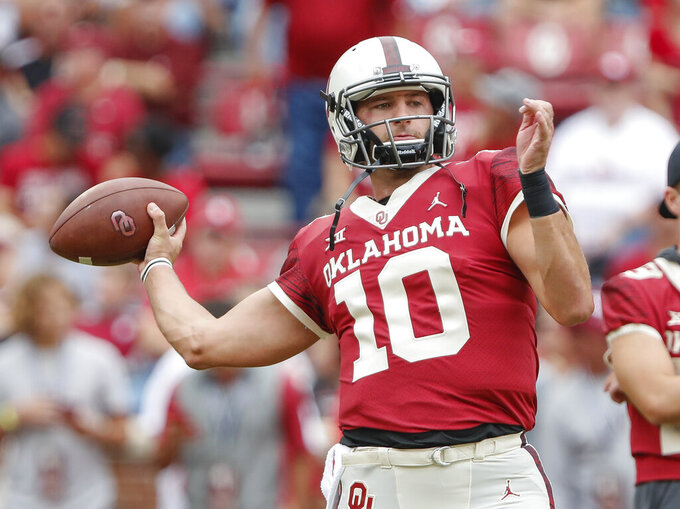 FILE - In this Sept. 29, 2018, file photo, then-Oklahoma quarterback Austin Kendall (10) warms up before the start of an NCAA college football game against Baylor in Norman, Okla. West Virginia coach Neal Brown announced Tuesday, Aug. 20, 2019, that Kendall will start the Mountaineers' season opener Aug. 31 against James Madison. Kendall is a graduate transfer from Oklahoma. (AP Photo/Alonzo Adams, File)