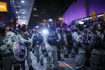 Riot Police petrol with face mask in the Tsim Sha Tsui district in Hong Kong, Thursday, Oct. 10, 2019. A Hong Kong government official said on Thursday that Apple was responsible for removing a smartphone application which allowed activists to report police movements. (AP Photo/Kin Cheung)