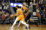 Orlando Magic's Markelle Fultz, front right, collides with Phoenix Suns' Dario Saric, back right, as Suns' Ricky Rubio (11) dribbles around the pick during the first half of an NBA basketball game Friday, Jan. 10, 2020, in Phoenix. (AP Photo/Darryl Webb)