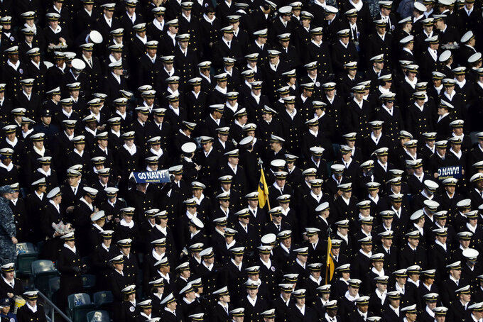Navy midshipmen watch as Army cadets march onto the field before an NCAA college football game, Saturday, Dec. 8, 2018, in Philadelphia. (AP Photo/Matt Slocum)