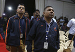 Indian Space Research Organization (ISRO) employees react as they listen to an announcement by organizations's chief Kailasavadivoo Sivan at its Telemetry, Tracking and Command Network facility in Bangalore, India, Saturday, Sept. 7, 2019. India's space agency says it has lost communication with its unmanned landing module which was to make a touchdown on the moon's south pole Saturday. (AP Photo/Aijaz Rahi)