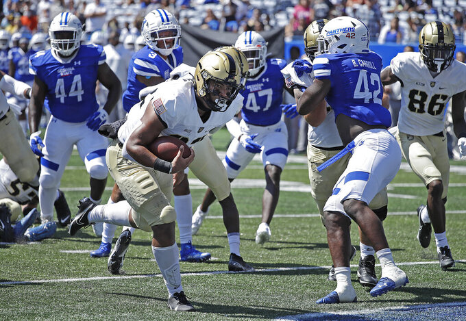 Army running back Tyson Riley, center, rushes for a touchdown against Georgia State during the first quarter of an NCAA football game Saturday, Sept. 4, 2021, in Atlanta. (AP Photo/Ben Margot)