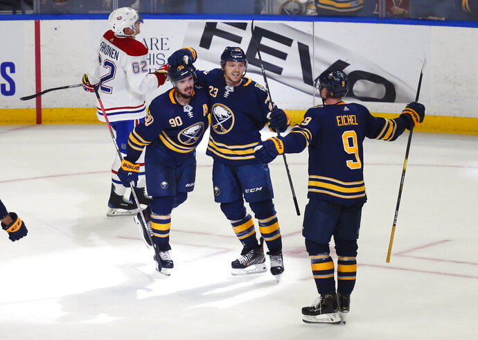 Buffalo Sabres forwards Marcus Johansson (90), Sam Reinhart (23) and Jack Eichel (9) celebrate a goal by Johansson during overtime in the team's NHL hockey game against the Montreal Canadiens, Wednesday, Oct. 9, 2019, in Buffalo, N.Y. (AP Photo/Jeffrey T. Barnes)