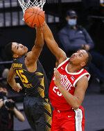 Iowa forward Keegan Murray (15) and Ohio State forward Zed Key (23) grab for a rebound in the first half of an NCAA college basketball game in Iowa City, Iowa, Thursday, Feb. 4, 2021. (Rebecca F. Miller/The Gazette via AP)
