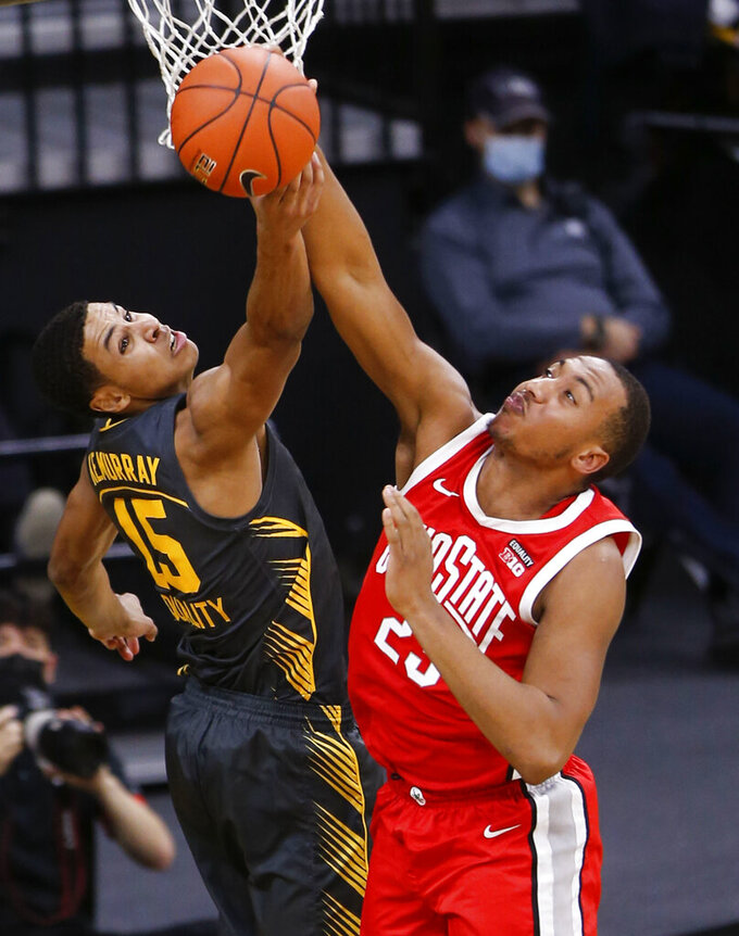 Iowa forward Keegan Murray (15) and Ohio State forward Zed Key (23) grab for a rebound in the first half of an NCAA college basketball game in Iowa City, Iowa, Thursday, Feb. 4, 2021. (Rebecca F. Miller/The Gazette via AP)