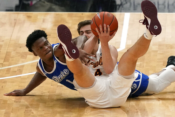 Loyola of Chicago's Braden Norris, right, and Drake's Joseph Yesufu dive after a loose ball during the second half of the championship game in the NCAA Missouri Valley Conference men's basketball tournament Sunday, March 7, 2021, in St. Louis. (AP Photo/Jeff Roberson)