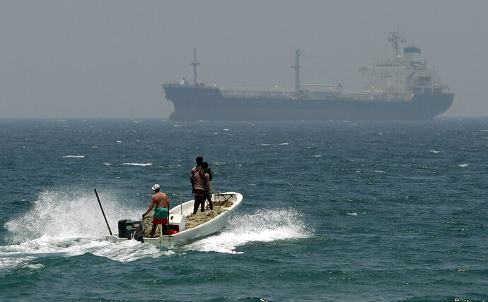 FILE - In this May 30, 2012, file photo, fishermen cross the sea waters off Fujairah, United Arab Emirates, near the Strait of Hormuz. The United Arab Emirates said Sunday, May 12, 2019 that four commercial ships near Fujairah