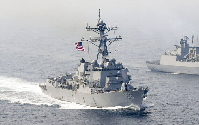 FILE - In this Tuesday, April 25, 2017, file photo released by the U.S. Navy, the Arleigh Burke-class guided-missile destroyer USS Wayne E. Meyer, left, is underway during a bilateral exercise with Korea. The operation by the USS Wayne E. Meyer on Friday demonstrated that the waters are beyond what China can claim as its internal waters or territorial seas under international law, said Cmdr. Reann Mommsen, a spokeswoman for the Navy's Japan-based 7th Fleet. (Mass Communication Specialist 3rd Class Kelsey L. Adams/U.S. Navy via AP)