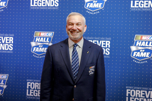 FILE - In this Jan. 20. 2017, file photo, former driver and television commentator Dale Jarrett poses for photographers on the red carpet before the start of the NASCAR Hall of Fame Induction ceremony in Charlotte, N.C. Jarrett says he has tested positive for coronavirus and now is in quarantine. The three-time Daytona 500 winner and 1999 Cup champion made the announcement during NBCSN's Hall of Fame announcement show on Tuesday. (AP Photo/Mike McCarn, File)