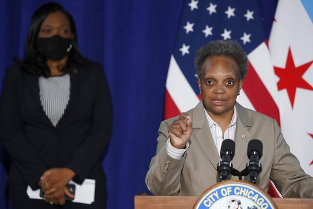 Mayor Lori Lightfoot, right, with Chicago Public Schools CEO Janice Jackson, announces CPS will begin the school year with remote learning, at a news conference in Chicago on Aug. 5, 2020. (Jose M. Osorio/Chicago Tribune via AP)