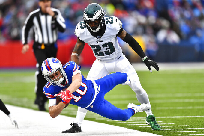 Buffalo Bills' Cole Beasley, left, is pushed out of bounds by Philadelphia Eagles' Rodney McLeod during the second half of an NFL football game, Sunday, Oct. 27, 2019, in Orchard Park, N.Y. (AP Photo/Adrian Kraus)