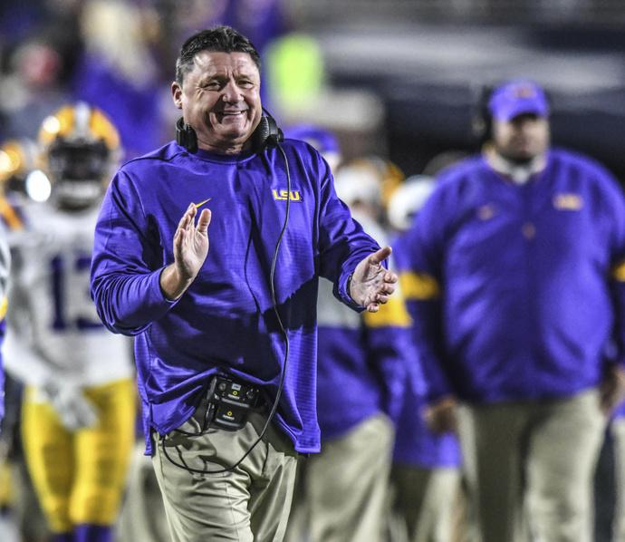 LSU coach Ed Orgeron smiles following an LSU touchdown against Mississippi during an NCAA college football game Saturday, Nov. 16, 2019, in Oxford, Miss. (Bruce Newman/Oxford Eagle via AP)