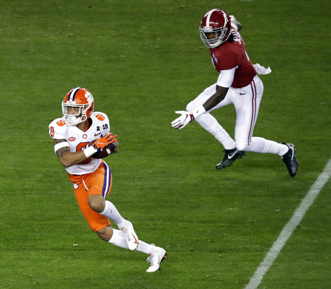 Clemson's A.J. Terrell intercepts a pass and returns it for a touchdown during the first half the NCAA college football playoff championship game against Alabama, Monday, Jan. 7, 2019, in Santa Clara, Calif. (AP Photo/Jeff Chiu)