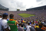 FILE - In this July 30, 2016, file photo, over 100,000 fans attend an International Champions Cup soccer match between Real Madrid and Chelsea at Michigan Stadium in Ann Arbor, Mich. The crippling grip the coronavirus pandemic has had on the sports world has forced universities, leagues and franchises to evaluate how they might someday welcome back fans. And while opinions vary from level to level, sport to sport and even nation to nation, one thing is universally clear: There won't be 100,000-plus fans packed into Michigan Stadium this fall, or 16,300 seated to the rafters of Allen Fieldhouse when hoops season rolls around. (AP Photo/Tony Ding, Fle)