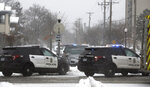 Authorities respond to the scene of a shooting on Oakland Avenue South, Sunday, Dec. 1, 2019, in Minneapolis. Two boys were found shot late Sunday morning outside the residence, where two adults were found dead later in the day. The two boys were also later pronounced dead, in what police are calling a