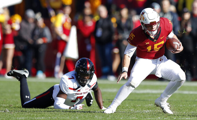 Iowa State quarterback Brock Purdy runs from Texas Tech defensive back Jah'Shawn Johnson, left, during the first half of an NCAA college football game, Saturday, Oct. 27, 2018, in Ames, Iowa. (AP Photo/Charlie Neibergall)