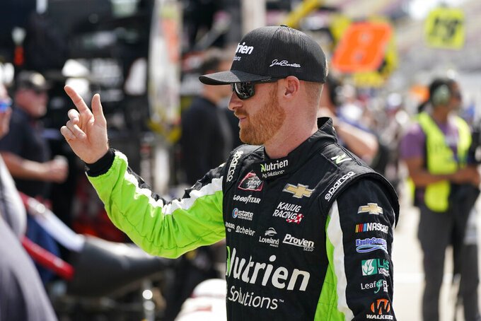 Jeb Burton talks to his pit crew before driver introductions at the NASCAR Xfinity Cup Series auto race at Michigan International Speedway, Saturday, Aug. 21, 2021, in Brooklyn, Mich. (AP Photo/Carlos Osorio)
