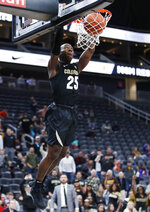 Colorado's McKinley Wright IV (25) dunks against Clemson during the second half of an NCAA college basketball game, Tuesday, Nov. 26, 2019, in Las Vegas. (AP Photo/John Locher)
