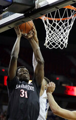 San Diego State's Nathan Mensah shoots during the second half of the team's NCAA college basketball game against Nevada in the Mountain West Conference men's tournament Friday, March 15, 2019, in Las Vegas. (AP Photo/Isaac Brekken)