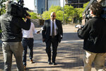 Former Reading Mayor Vaughn Spencer, convicted of exchanging public works contracts for campaign contributions, arrives for his sentencing hearing at the federal courthouse in Philadelphia, Wednesday, April 24, 2019. (AP Photo/Matt Rourke)