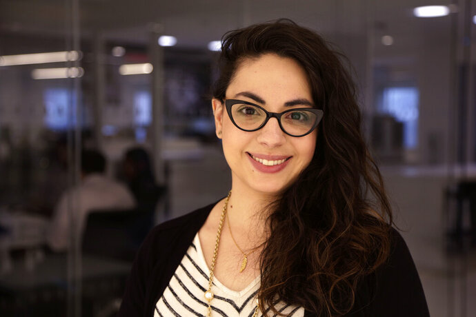 Christina Paciolla in the Associated Press newsroom in New York on Tuesday, Nov. 19, 2019. Paciolla was named AP's News Editor for Pennsylvania, Ohio and New Jersey today. (AP Photo/Peter Morgan)