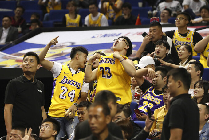 FILE - In this file photo taken Oct. 10, 2019, Chinese fans react during a preseason NBA basketball game between the Brooklyn Nets and Los Angeles Lakers at the Mercedes Benz Arena in Shanghai, China. CCTV announced Friday, Oct. 9, 2020 that it would air Game 5 of the NBA Finals between the Los Angeles Lakers and Miami Heat — the first time that the league would appear on the network since the rift that started when Houston Rockets general manager Daryl Morey tweeted support for anti-government protesters in Hong Kong. (AP Photo, File)