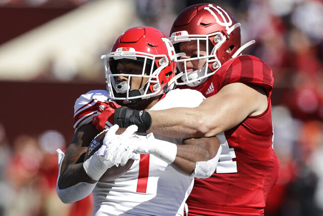 FILE - In this Oct. 12, 2019, file photo, Rutgers running back Isaih Pacheco, left, is tackled by Indiana linebacker Thomas Allen, right, during the first half of an NCAA college football game, in Bloomington, Ind. Allen had season-ending surgery on his left shoulder in November, and his dedication and focus during rehabilitation led him to recently declare himself 85 to 90 percent healthy. His recovery plan changed dramatically when the coronavirus pandemic led to the suspension of athletic activities. (AP Photo/Darron Cummings, File)