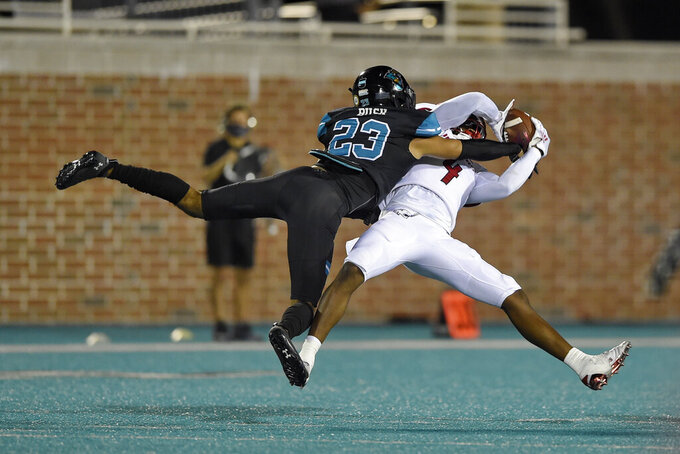 South Alabama's Jalen Wayne (4) catches a pass while defended by Coastal Carolina's Derick Bush during the second half of an NCAA college football game Saturday, Nov. 7, 2020, in Conway, S.C. (AP Photo/Richard Shiro)