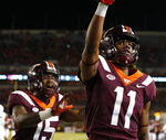 Virginia Tech wide receiver Tre Turner (11) celebrates a touchdown catch with teammate Sean Savoy (15) during the first half of an NCAA college football game against Georgia Tech in Blacksburg, Va., Thursday, Oct. 25, 2018. (AP Photo/Steve Helber)