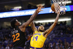 FILE - In this March 2, 2019, file photo, Los Angeles Lakers forward Brandon Ingram (14) shoots next to Phoenix Suns' DeAndre Ayton during an NBA basketball game in Phoenix. Two people familiar with the situation say the New Orleans Pelicans have agreed to trade six-time All-Star Anthony Davis to the Lakers for point guard Lonzo Ball, Ingram, shooting guard Josh Hart and three first-round draft choices. The people spoke to The Associated Press on condition of anonymity because the trade cannot become official until the new league year begins July 6. ESPN first reported the trade. (AP Photo/Rick Scuteri, File)
