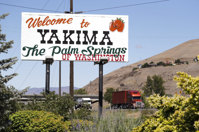 In this photo taken Wednesday, June 17, 2020, a sign declares off the highway in Yakima, Wash., declares the city the