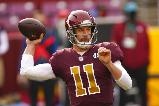 Washington Football Team quarterback Alex Smith (11) passing during the first half of an NFL football game against the Cincinnati Bengals and Washington Football Team, Sunday, Nov. 22, 2020, in Landover. (AP Photo/Andrew Harnik)