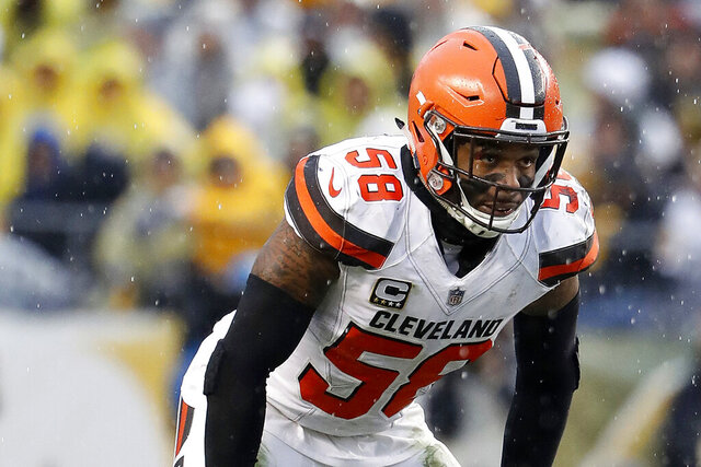 FILE - In this Oct. 28, 2018, file photo, Cleveland Browns outside linebacker Christian Kirksey is shown during an NFL football game against the Pittsburgh Steelers in Pittsburgh.  Kirksey believes his history with his new defensive coordinator will help the veteran linebacker make a smooth transition as he switches teams for the first time in his NFL career. Kirksey signed with the Green Bay Packers in March after getting released by Cleveland, where he spent his six NFL seasons. Packers defensive coordinator Mike Pettine was the Browns' head coach in 2014-15. (AP Photo/Winslow Townson, File)