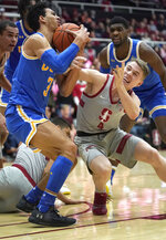 UCLA guard Jules Bernard (3) battles for a loose ball against Stanford guard Isaac White (4) during the first half of an NCAA college basketball game Saturday, Feb. 16, 2019, in Stanford, Calif. (AP Photo/Tony Avelar)