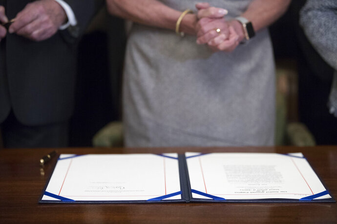 The signature of House Speaker Nancy Pelosi of Calif., is visible on a deal to reopen the government on Capitol Hill in Washington, Friday, Jan. 25, 2019. (AP Photo/Andrew Harnik)