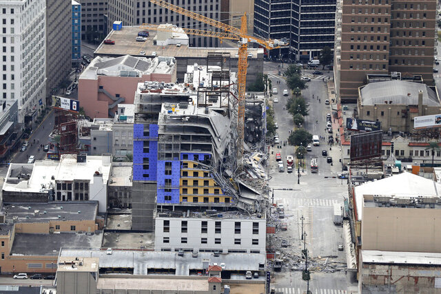 FILE - This Oct. 12, 2019, file aerial photo shows the Hard Rock Hotel, which was under construction, after a fatal partial collapse in New Orleans. Crews on Saturday, Aug. 8, 2020, recovered the body of one of two construction workers that had been trapped in the collapse nearly 10 months ago of a Hard Rock Hotel under construction in New Orleans. (AP Photo/Gerald Herbert, File)