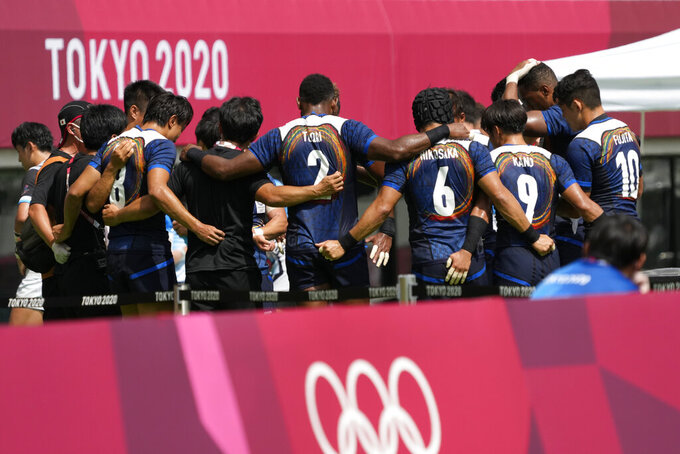 Japan players huddle up after winning their men's rugby sevens 11-12 placing match against South Korea at the 2020 Summer Olympics, Wednesday, July 28, 2021 in Tokyo, Japan. (AP Photo/Shuji Kajiyama)