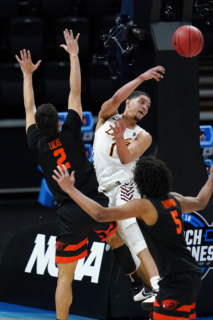 Loyola Chicago guard Lucas Williamson (1) passes ahead of Oregon State guard Jarod Lucas (2) during the second half of a Sweet 16 game in the NCAA men's college basketball tournament at Bankers Life Fieldhouse, Saturday, March 27, 2021, in Indianapolis. (AP Photo/Jeff Roberson)
