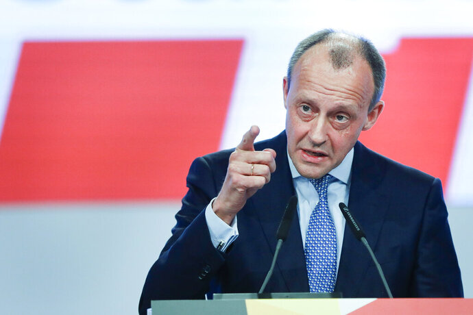 Party member Friedrich Merz addresses the delegates during a Christian Democratic Union party convention in Leipzig, Germany, Friday, Nov. 22, 2019. (AP Photo/Jens Meyer)