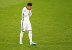 England's Jadon Sancho reacts during a penalty shootout at the Euro 2020 soccer championship final between England and Italy at Wembley stadium in London, Sunday, July 11, 2021. (John Sibley/Pool Photo via AP)